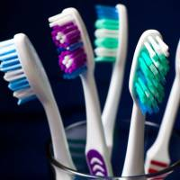 9 Uses for a Toothbrush in Your Beauty Routine ...