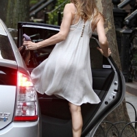 3 Photos of SJP in White ...