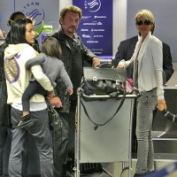 14 Photos of Hallyday and Family Depart ...