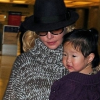 2 Photos of Heigl at JFK ...
