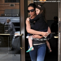 2 Photos of Katie Carrying Suri ...
