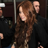 4 Photos of Miley Cyrus Waving to Fans...