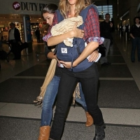 6 Photos of Gisele Bundchen Keeping Her Baby Close...