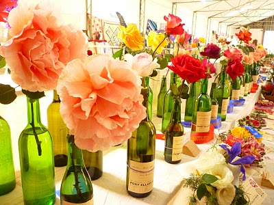 Awesome ideas for getting creative with wedding flowers for Wine bottle vase ideas