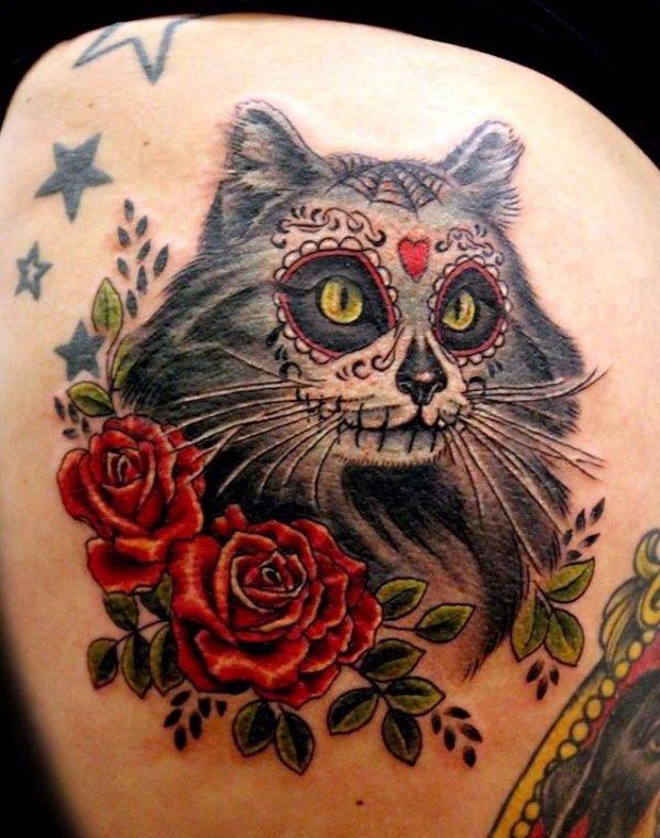 tattoo,cat,arm,tattoo artist,cat like mammal,
