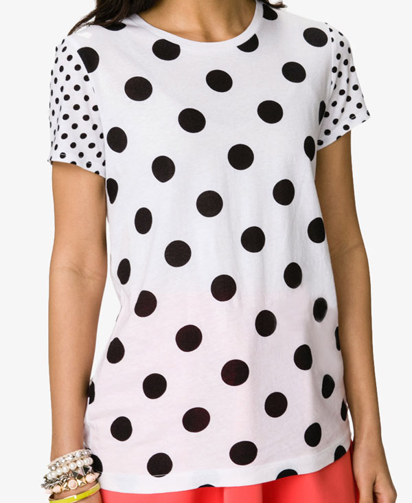 While solid colored polka dots convey a fun traditional look, you can mix things up in a playful way by selecting a women's cheap polka dot shirt with bright, bold, multi-colored polka dots. Choose your favorite dot color and carry through with similarly colored accessories, bag and shoes.