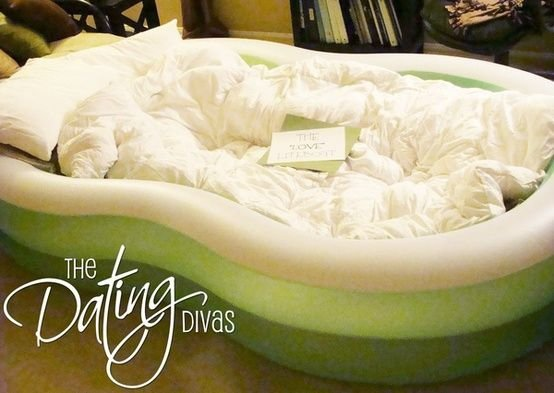 Blow up Kiddie Pool and Fill with Pillows and Blankets for a Cozy Bed