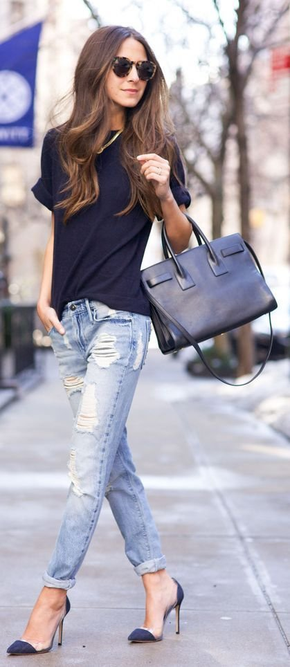 Throw on Some Dual Tone Shoes, a Casual Tee and a Leather Bag to Show the World You Mean Business