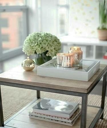 Bottom shelf 53 coffee table decor ideas that don 39 t for Coffee table centerpiece