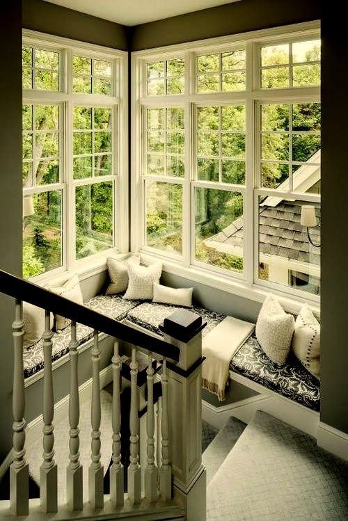 Corner window ledge love books here 39 s a reading nook Window seat reading nook
