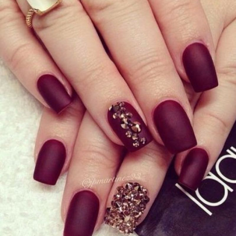Maroon matte nails with gold rhinestone accent