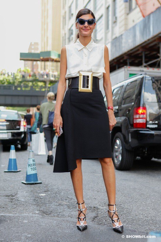 Try a Sleeveless Button down with a Black Skirt and Statement Belt