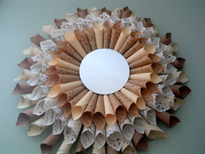 this diy sunburst mirror has a frame of sheet music manila paper paper doilies and brown craft paper