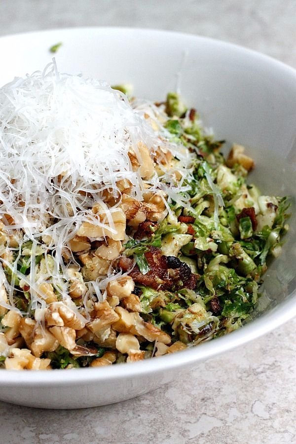 Warm Bacon and Brussels Sprouts Shredded Salad Tossed with Chopped Walnuts and Fresh Parmesan