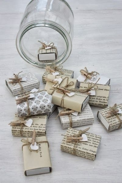 A mason jar holds 24 tiny gifts hidden inside decorated matchboxes.