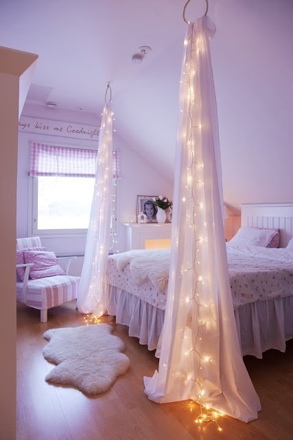 Bed Canopy. It's so easy to inject romance into the bedroom with some tulle  and strings of Christmas lights.