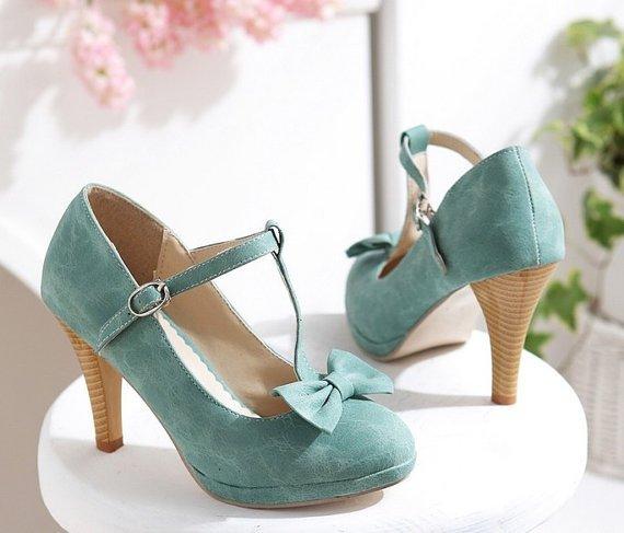 footwear,green,high heeled footwear,leg,leather,