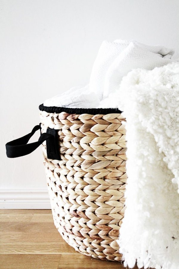 In a Decorative Basket on the Floor