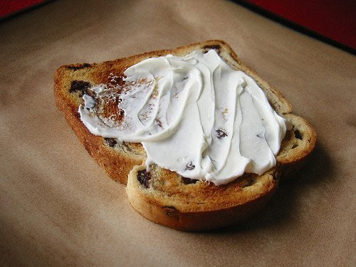 Replace a Cinnamon Roll with 2 Slices of Raisin Toast with 1 Tbsp Low-fat Cream Cheese and 1 Tsp Powdered Sugar. Sprinkle with Cinnamon