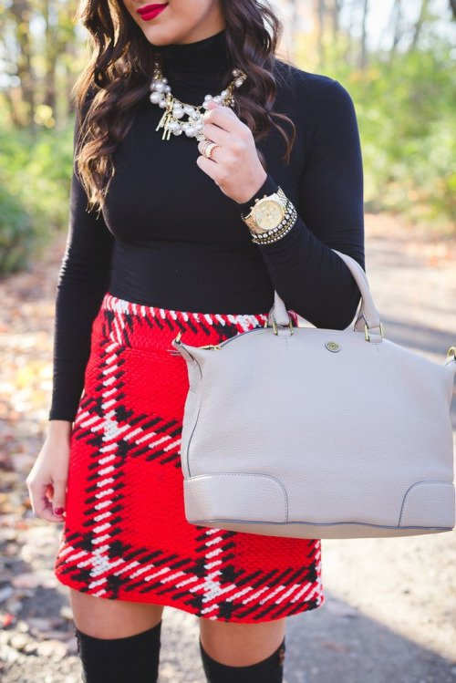 Black Turtleneck Sweater with a Plaid Skirt