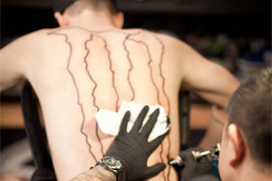 Stupid advertising tattoos 7 desperate acts that led to for Rob dyrdek tattoos