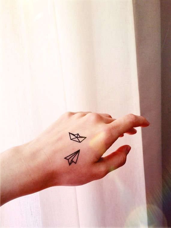 Small Paper Boat and Airplane