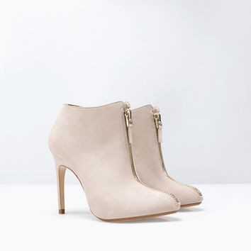 21 high heel ankle boot with zip the secret to wearing