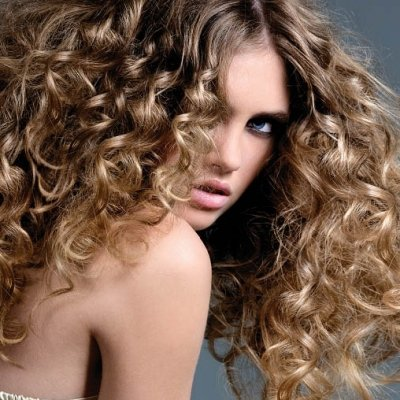 7 Hairstyles for Curly Hair That You Probably Haven't Tried Yet ...