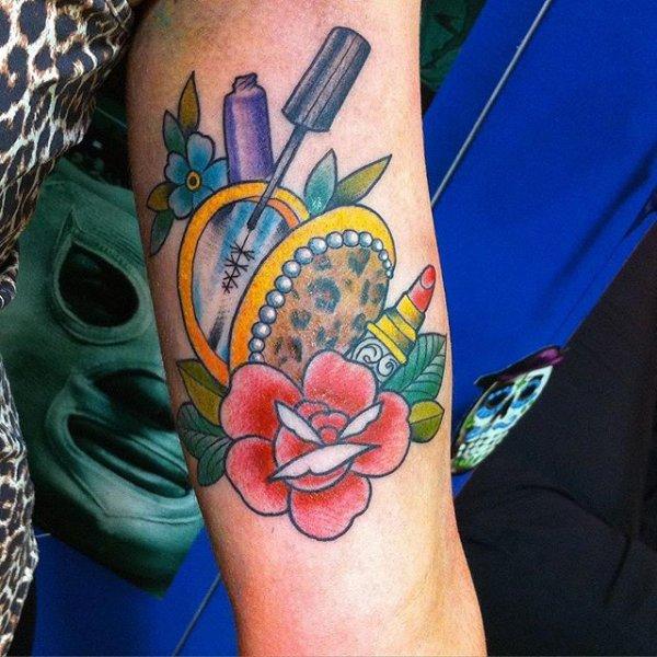 tattoo,arm,flower,tattoo artist,human body,