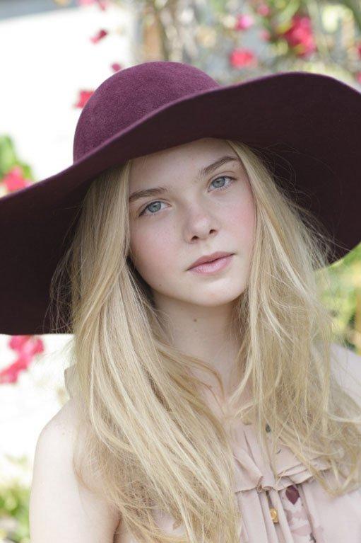Elle Fanning's Pale Beauty Offset by Plum Fedora