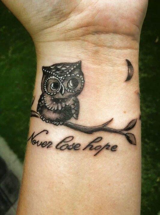 tattoo,arm,pattern,hand,human body,