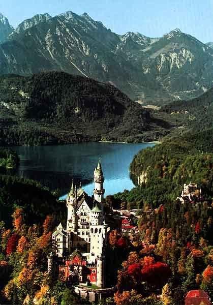 Neuschwanstein Castle,mountainous landforms,town,mountain,mountain range,