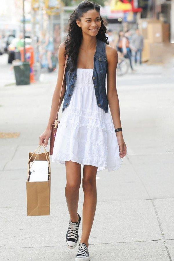 Chanel's Denim Vest over a White Dress
