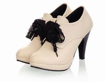 footwear,shoe,high heeled footwear,leather,leg,