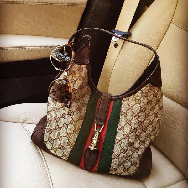 handbag, bag, brown, footwear, car seat,