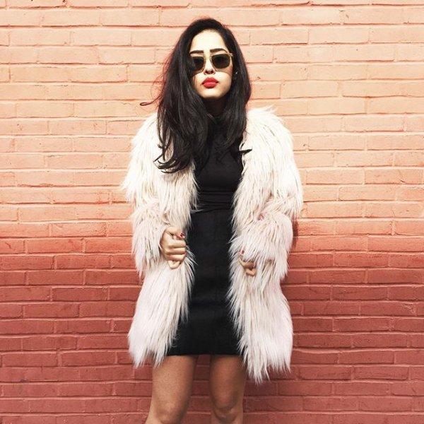 clothing, fur, footwear, black hair, fur clothing,