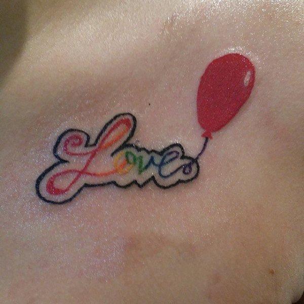 tattoo,pink,skin,arm,organ,