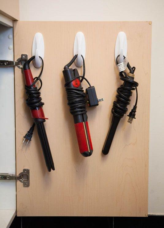 Hang on Hooks on the inside of Cabinet Doors