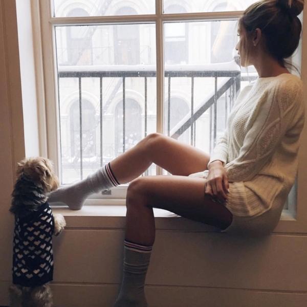 clothing,human positions,sitting,leg,footwear,