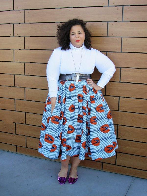 With a Voluminous Midi Skirt