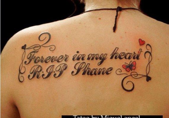 tattoo,font,arm,human body,chest,