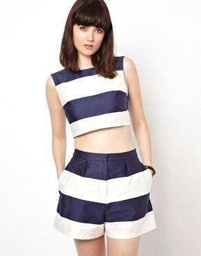 clothing,sleeve,cheerleading uniform,dress,abdomen,