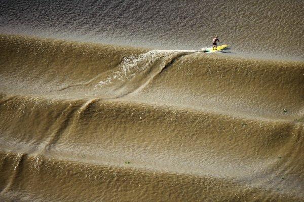 Pororoca Amazon Surfing in Cutias, Brazil