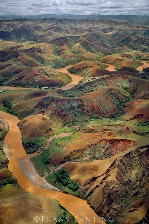 Deforested Hills and Silt-laden River