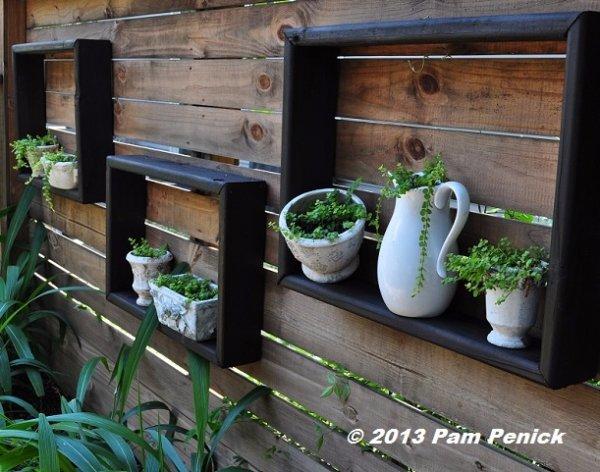 Display Little Potted Plants inside Square Shelves