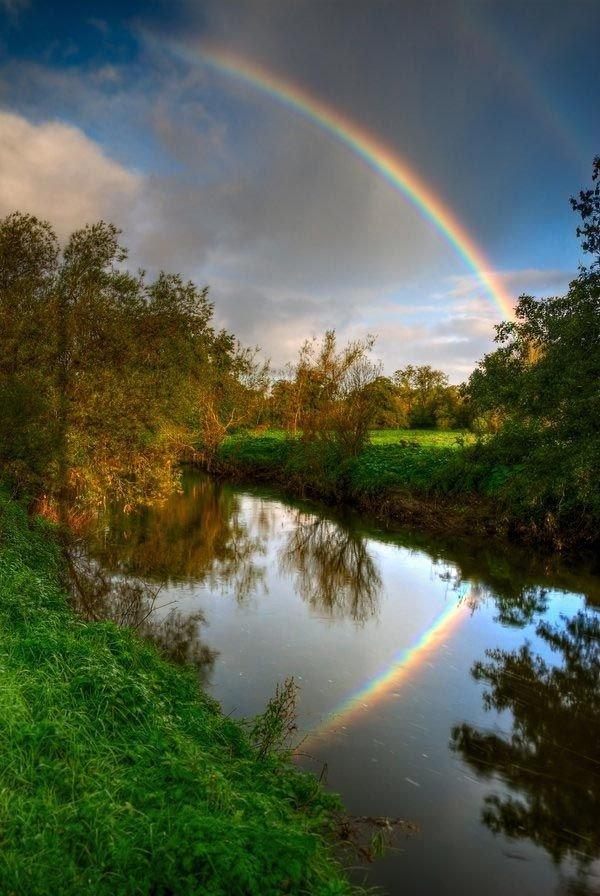 rainbow,sky,nature,reflection,atmospheric phenomenon,