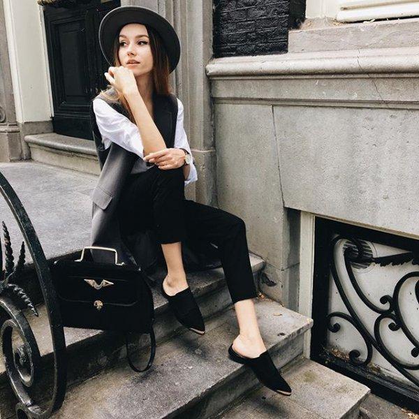black, clothing, human positions, sitting, footwear,