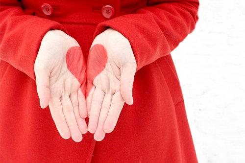 red,finger,hand,outerwear,abdomen,