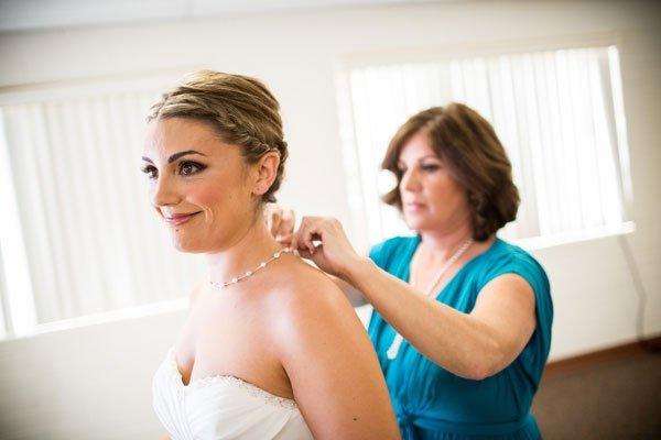 Mom Helping Bride Get Ready