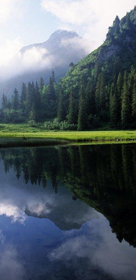 highland,reflection,mountainous landforms,nature,atmospheric phenomenon,